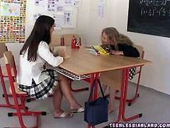 Naughty lesbian schoolgirls Goldie & Nicol are having fun at school. They take off their sexy uniforms and start sucking their tight pussies!
