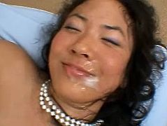 Tiffany gives a blowjob to fat guy in glasses. Then she lies down on a bed and gets her Asian pussy fucked. She also gets jizzed on her face.