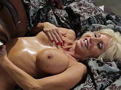 Make sure you have a look at this hardcore scene where the busty blonde milf Tara Holiday is fucked by a big black cock in this interracial video.