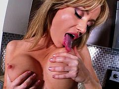 Angela Sommers masturbates after showing off her body