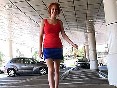 Share this with your friends! A hot redhead, with natural jugs wearing a miniskirt, while she masturbates in a restaurant, and later walks naked!
