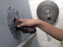 That amazing babe is in public toilet rubbing and fingering her cunt and then black glory hole cock comes. She sucked and fucked that huge cock.