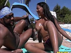 Salacious chick Aline Queiros allows some guy to play with her big fake tits on the poolside. Then she rubs the dude's boner and they fuck in reverse cowgirl position and doggy style.