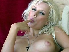 Solo pornstar with blonde hair showing natural tits