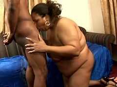 Slutty ebony BBW gives passionate blowjob to Black dude. Then she gets fucked doggystyle and gets facialized massively.