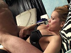 Salacious brown-haired shemale Miresa T is playing dirty games with some dude indoors. She lets him suck her boner and then drills his ass in missionary and other positions.