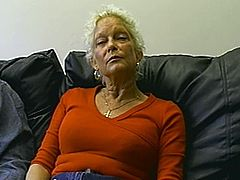 Nasty blonde granny is having fun with some guy indoors. She kneels in front of the man and pleases him with a blowjob and then they bang in the reverse cowgirl position.