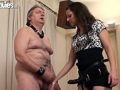 A fucking dirty old dude gets tied up and chained to the wall by some cunt that toys with him all the wile. Check it out!