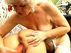 Blonde mature ladies are sharing a big toy during their nasty lesbian action