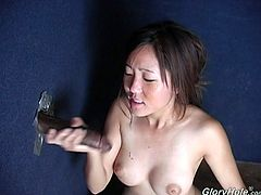 Petite Asian girl takes clothes off and then starts to suck big black cock. She also shows off her shaved pussy and pleases the guy with hands.