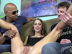 Get wild watching this brunette, with natural boobs and a shaved kitty, while she gets touched and fucked by two nasty guys. She is fucking crazy!