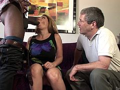 White chick and a man suck big black cock with pleasure. They like big dicks, so they get a lot of pleasure. In the end the Black dude cums on tits.