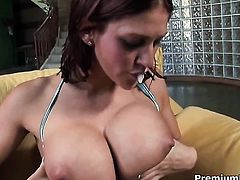 Eve Laurence with gigantic melons has fire in her eyes as she takes pop shot on her lovely face