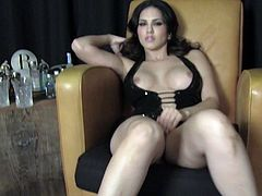 Alluring brunette Sunny Leone is getting naughty in amazing solo clip. She takes her clothes off and strokes her terrific body and then shows her ass and pleases herself with fingering.