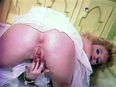 Blonde hooker in white pantyhose masturbates rubbing her cunt