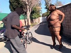Ms Lottittes poses almost naked in the street. She invites some guy in her house. She gives him a blowjob and then gets her pussy drilled.