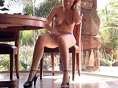 Beautiful blonde girl in hot solo video. She shows off her niec tits in close-up scenes. Later on she sits down on the floor and starts to play with her pussy.