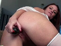 Brandie Jones is a busty cougar who simply loves to pleasure herself with the right toys. She picks a red vibrator to fuck her pussy with this time and does well.
