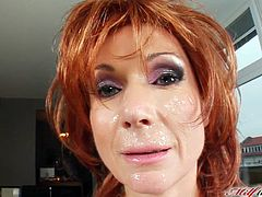 Slutty redhead woman lifts a dress up to show her bald pussy. She attracts enough attention. So, they guy comes up to Nina and starts to fuck her in the ass. He also cums on her happy face.