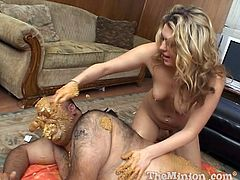 Fat guy hammers her doggystyle then lays back and enjoys it as she works his cock while rubbing his body in peanut butter.
