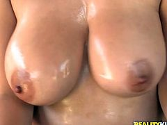 Brunette MILF fondles and oils up her huge boobs. She sucks a dick and licks balls. After that she gives an unforgettable titjob and gets fucked through the hole in pantyhose.