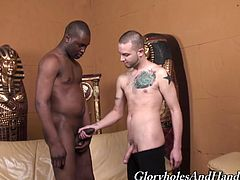 Tattooed White guy comes up to muscled Black dude. Johnathan takes big black cock in his right hand and starts to stroke it.