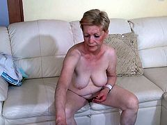 Chubby nasty granny fucks herself with a dildo in hairy old pussy