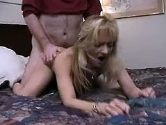 Blonde woman gives skillful blowjob to some guy in a bedroom. Later on she gets fucked in a doggystyle and missionary positions.