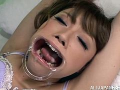 She gets a damn speculum in her mouth and her doctor stuffs her with his huge cock! Damn, she is going to eat some cum.