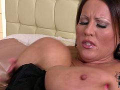Raunchy MILF wearing corset and stockings is a proud proprietress of huge milky tits. Thick bitch sucks and squeezes her giant rack and licks her nipples as well.