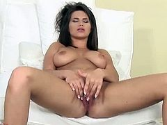 Make sure you don't miss the hot titties of this brunette babe named Chintya Doll. She opens her legs wide to stretch her tight pussy and make herself cum.