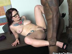 Slutty Misty Dawn sucks huge dick standing on her knees. Later on she gets fucked rough on a table and a sofa. The guy also cums on her glasses.