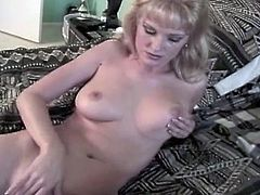 Sexy blonde chick with natural boobs plays with her pussy lying on a bed. Later on she gets fucked from behind. She also gets her mouth filled with cum.