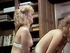 Duet of curly blonde office girls get naughty at the workplace. Chicks kiss with tongues and joyfully eat each other's moist hairy coochies.