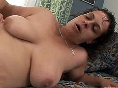 Fat brunette woman lies on a bed sucking a dick. Later on she gets fucked deep and hard in doggystyle position. She also gets her vagina filled with cum.