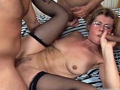 Make sure you have a look at this hardcore scene where this horny mature lady's fucked silly by these two guys.
