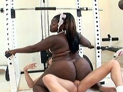 Gym instructor gets horny over ebony bbw chick's huge ass and starts fucking her wet pussy in this great interracial hardcore video