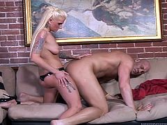 A dominant chick straps on a dildo and fucks this horny dude in his tight asshole. The look on his face is fuckin' priceless. Check it out!