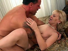A horny old fart gets her fuckin' slit stuffed with a stud's cock