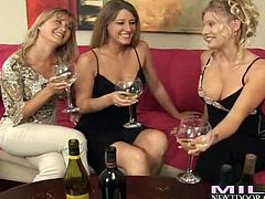 Three old friends talk to each other and drink wine. They have a great time together but then they make this meeting even better. MILF's take dresses off and start to finger themselves lying on a sofa.