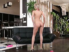Blonde finds herself horny as hell and takes sex toy in her fuck hole