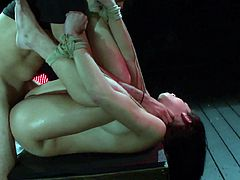 Lovely gal dominated in bondage scene