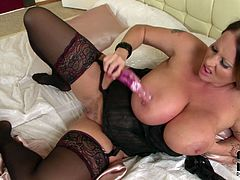 BBW mommy with massive natural tits sucks her nipples and smears fancy dildo with her spit before shoving that sex toy up her tight smooth asshole.