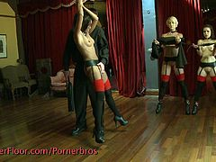 These slaves are getting tortured by their master and he spanks pussy, squeezes tits, and strings them up. Then the second master shows up and uses toys on them before they get fingered and one slave has to eat out the other.