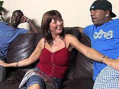 Horny white housewife Desi brings a couple of black guys home and gets her pussy and mouth filled with throbbing black cock.