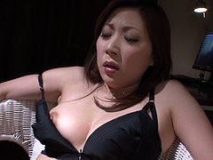 This Asian bimbo is bound hand and foot and ready for punishment! Horny dude tickles her fanny with a pink sex toy until she cums.