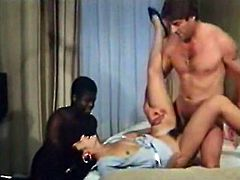 Dark haired broad assed whorish bim gives awesome blowjob to candied BBC and her loose booty hole got invaded by long white schlong from behind. Take a look at this hot 3some poking in The Classic Porn sex clip!