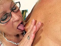 Check out these two moms sharing a big strapon between their wet vags
