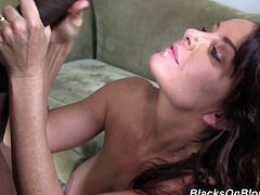 Janet Mason sucks big black cock and licks balls. Then she takes clothes off and gets her pussy destroyed. This cougar also gets facialed.