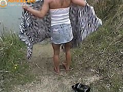 Watch this hot busty blonde amateur babe with her boyfriend in this outdoor video, where she strips her clothes off and shows her hot assets on the camera.Than she sits on her knees and sucks his big cock.